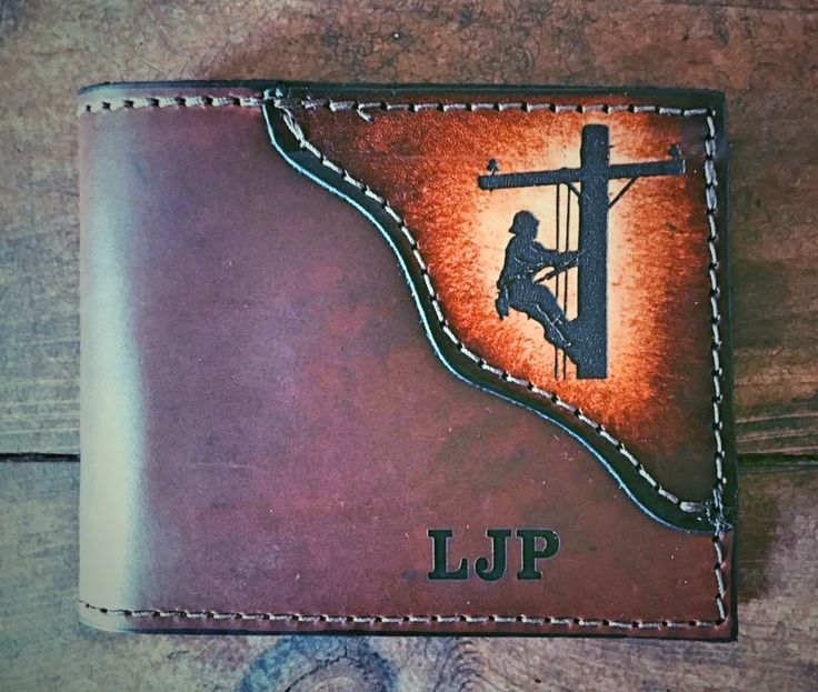 LINEMAN wallet, Classic BI FOLD is shown, Father's day gift, lineman gifts, wallet with a lineman, line man,  Initials Engraved Free! by MillersLeatherShop on Etsy https://www.etsy.com/listing/281554502/lineman-wallet-classic-bi-fold-is-shown