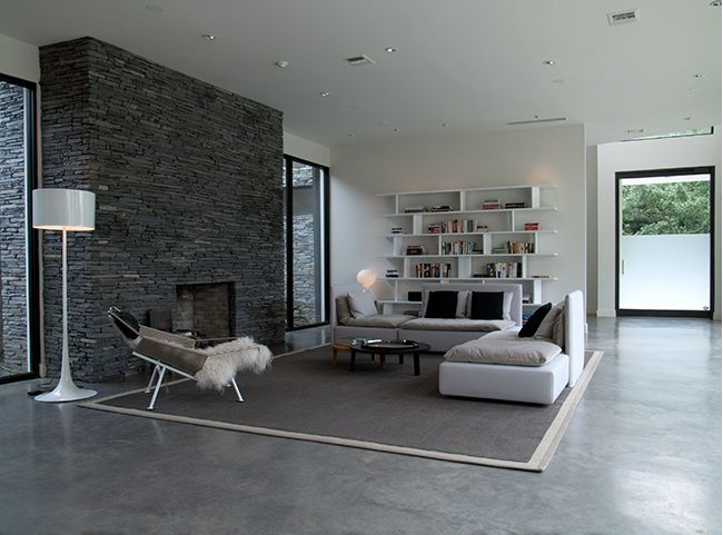 Modern Living Room With Concrete Floor And Minimal Fireplace In A Loft De