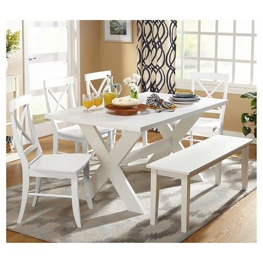This charming 6pc Sumner dining set is stylish and functional and will look good in your dining room. It includes one white table that has an X-base design, one white bench and four chairs with an X-back design that is available in multiple colors.  This transitional dining set is made of MDF and rubberwood for durability. Required some assembly.