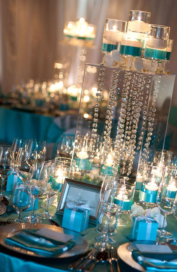 Chic Tiffany blue wedding centerpiece with candles & crystals.