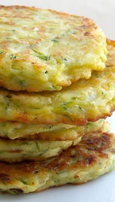 ZUCCHINI PATTIES 2 cups grated zucchini (one medium sized zucchini) 1/2 small onion, finely diced 1 large egg 1/4 cup grated Parmesan cheese 1/2 cup all-purpose flour Salt and Pepper Olive oil *You could add garlic or herbs for some extra flavor