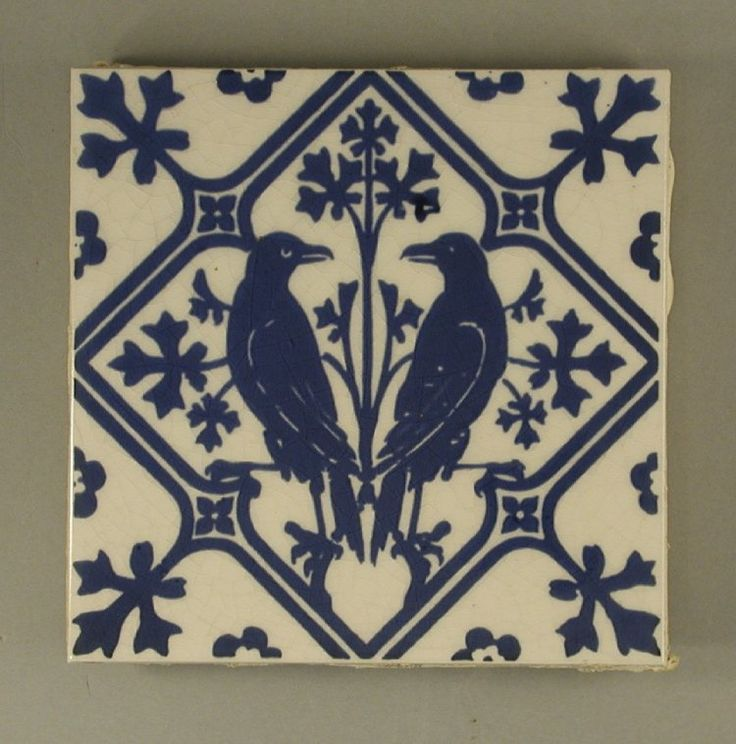 Single tile, formed of two tiles stuck together, a front and a back, the front screen-printed in blue under glaze with a design of two addorsed ravens, the back with Mintons makers mark faintly  visible. A fake copy of a Minton tile designed by Pugin.