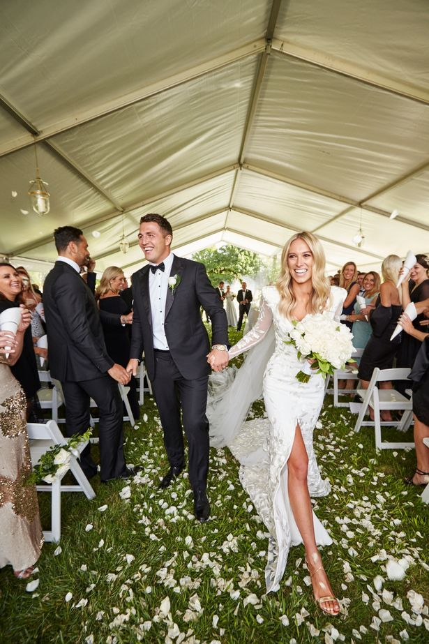 This thigh high split is daring - but Phoebe Cooke totally pulls it off as she marries Sam Burgess.