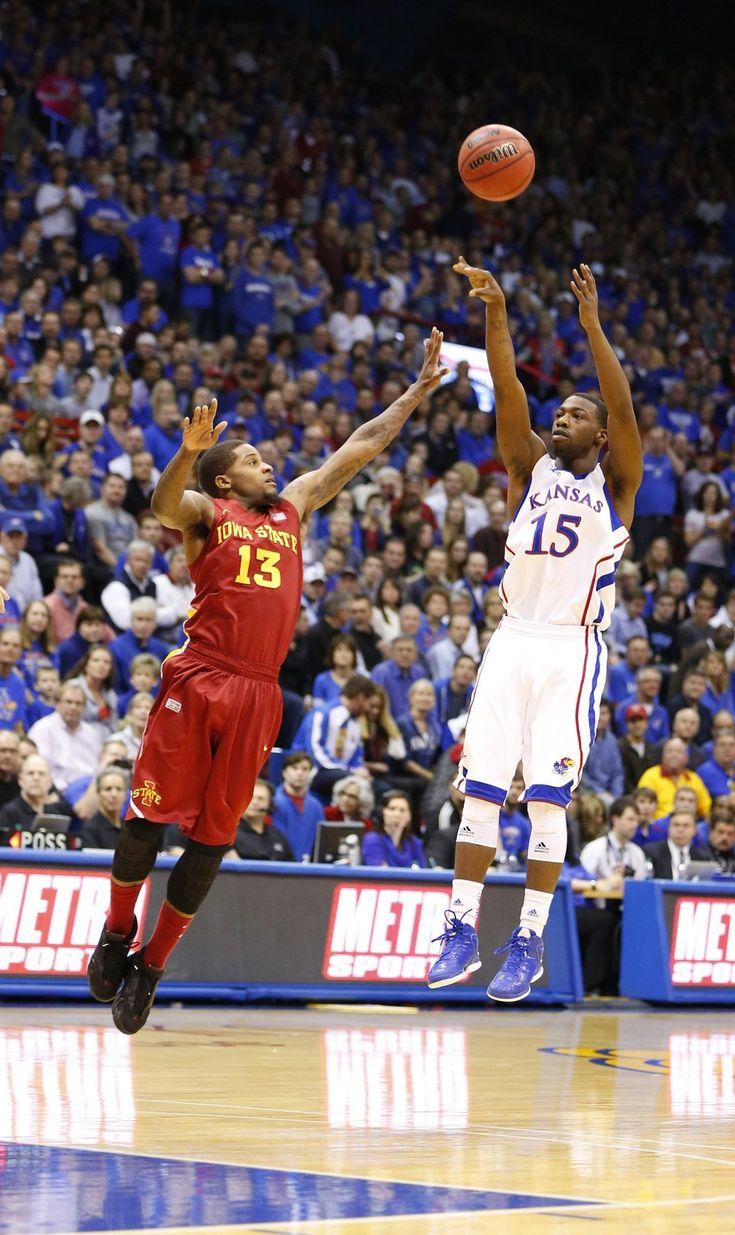 Kansas guard Elijah Johnson puts a three in the    air