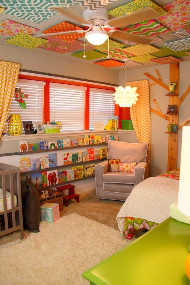 Foam boards covered in fun fabrics for the ceiling in the play room. Love this room!