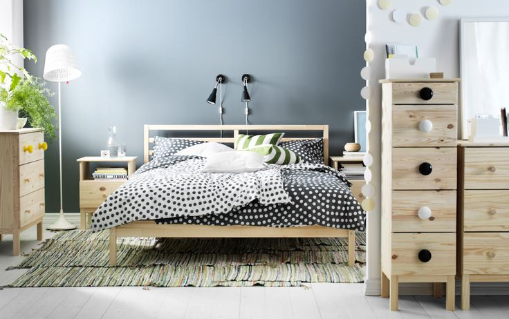 A bedroom with TARVA solid wood bed frame, chest of drawers and bedside table