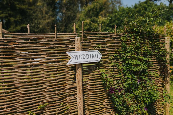 Don't forget your wedding signage to let your guests know where to go. Photo by Benjamin Stuart Photography #weddingphotography #signage #weddingsign #weddingideas #ceremonydecor #wedding
