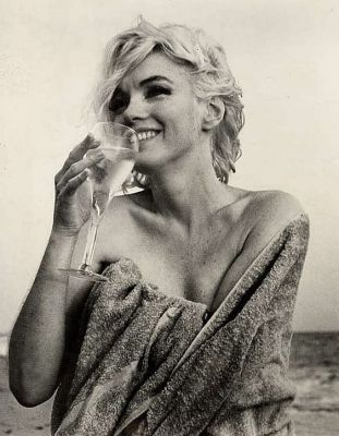 Marilyn Monroe drinking her vino ,and happy!