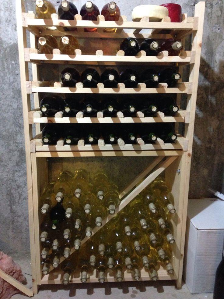 My homemade wine rack wine pinterest homemade for Wine bottle shelf diy