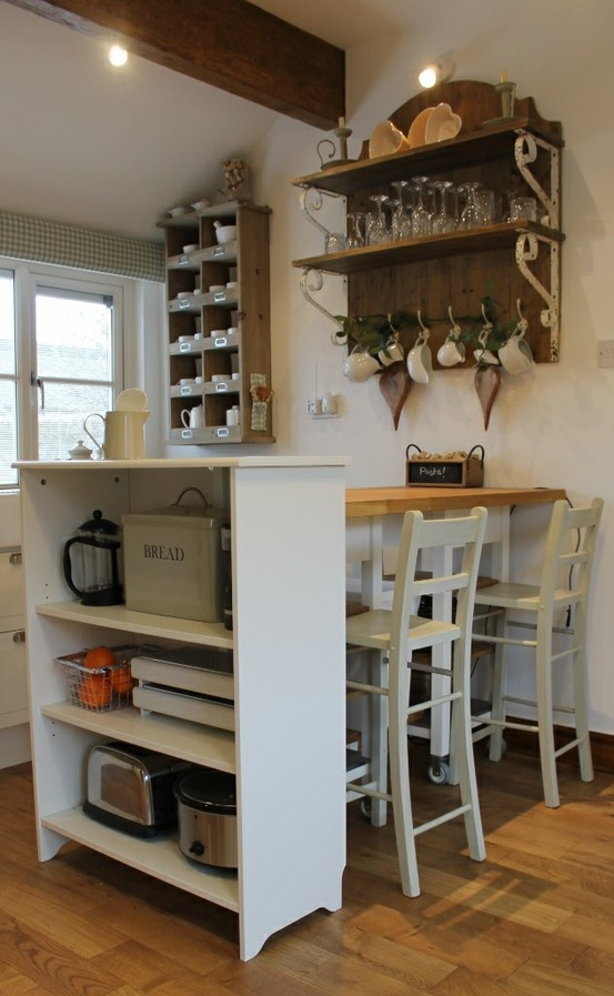 Combining different storage solutions to enhance a small for Small kitchen wall storage solutions