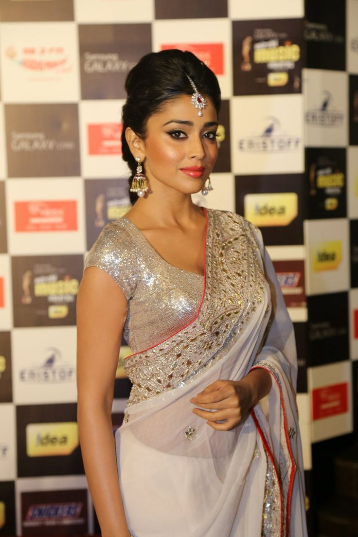 Shriya saran in white saree http://www.pinterest.com/amina520/indian-outfits/