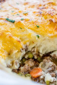 """Try this """"Classic Shepherd's Pie with Crispy Cheddar Topping"""" from The Food Charlatan - beef part of this recipe has onion, carrots and peas, and is seasoned with beef broth, Worcestershire sauce, and Better Than Bouillon paste."""