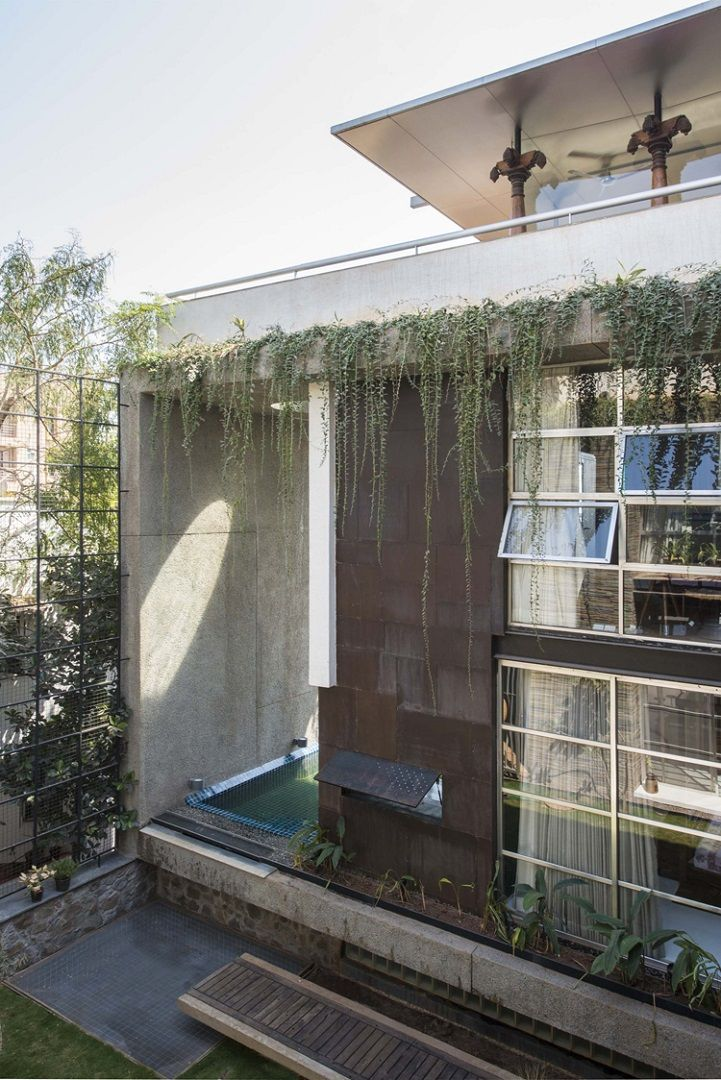 By Larue Architects: Architects Recycle Found Doors And Windows To Form Faade Of A Collage House