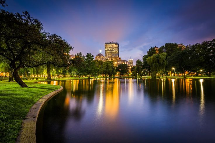 The lake at the Public Garden and buildings at Copley at night, in Boston, Massachusetts.