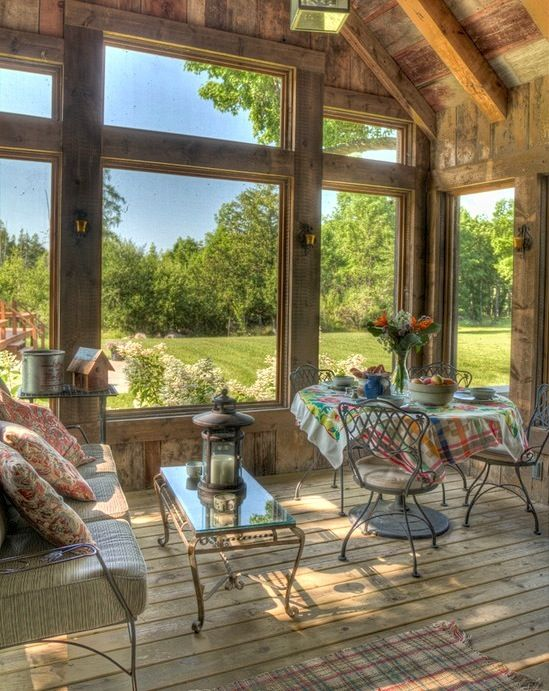 Rustic sunroom off kitchen connected to the outdoor kitchen. winter sunroom summer entertaining