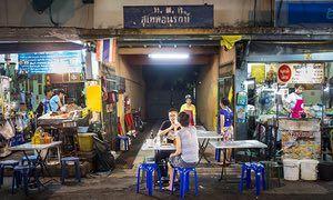 People eat at street food stalls on Sukhumvit Soi 38 in Bangkok.