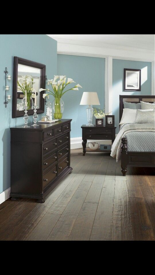 Dark furniture, blue walls, wood floors. I love this!!!!