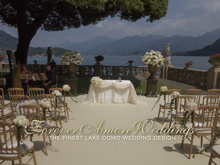 Lake Como wedding, ceremony at Villa Balbianello, Lake Terrace. Set-up with platform and ivory carpet, flower arrangements in white, ivory and pale pink. Picture by ForeverAmoreWeddings ©