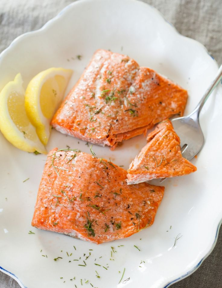 """How To Cook Salmon in the Oven–If you want """"easy, fancy,"""" it doesn't get much better than roasted salmon fillets.  we're showing you the easiest, simplest way to cook salmon in the oven. It's the kind of recipe to keep in your back pocket — though it's hardly a recipe at all."""