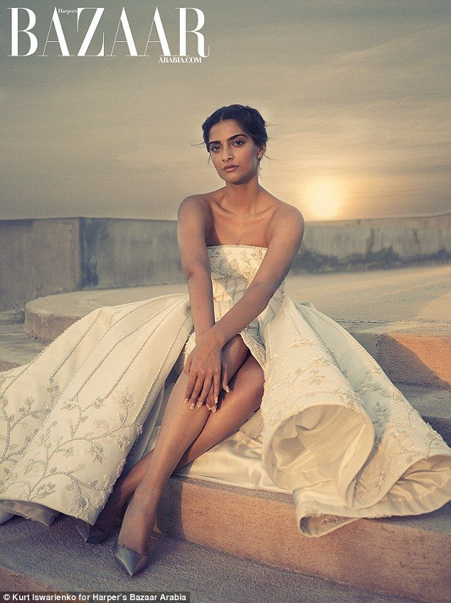 Indian actress Sonam Kapoor, is one of Bollywoods biggest stars. In a new shoot for Harper's Bazar Arabia, she wears a srapless off-white gazar flared dress embroidered with sequins and pearls and Christian Louboutin shoes