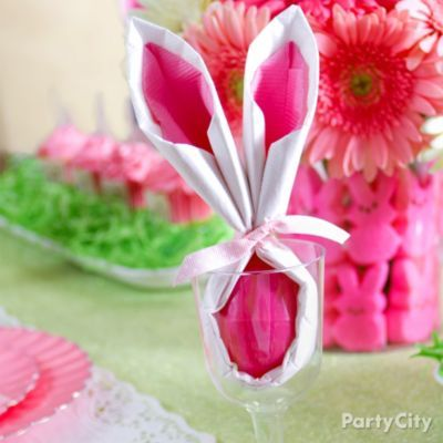 How To - Bunny Napkin (paper) wrapped around plastic eggs and tied with ribbon.