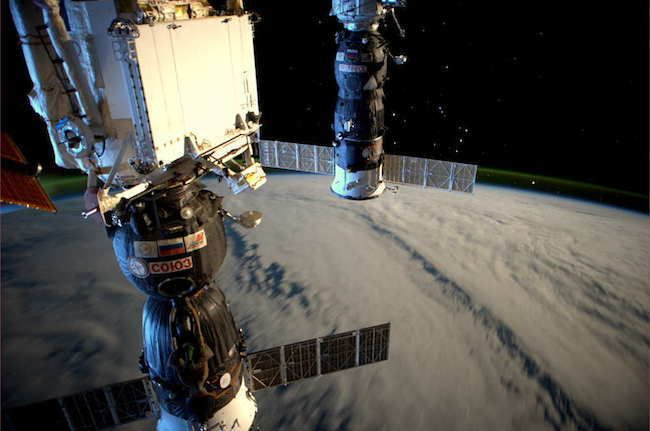 Station Illuminated By Light & Reflected By The Moon 30 Stunning Pictures Of Earth Taken From Space • Page 5 of 6 • BoredBug