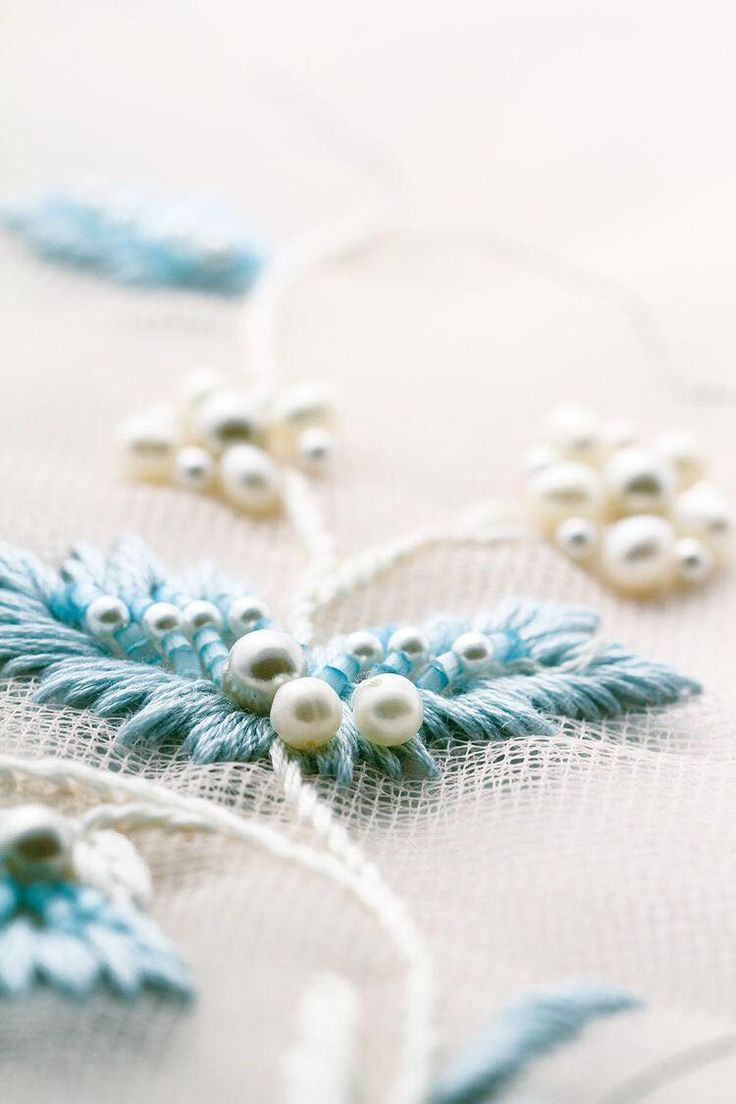 Blue string and pearl embroidery on tulle
