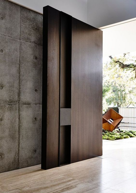 oversized dark wooden front door