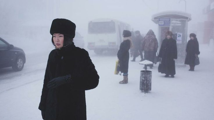 A Yakutian woman in the city centre. Steam from factories, cars and people creates a thick fog in winter which lingers through the coldest weeks. (Amos Chapple)