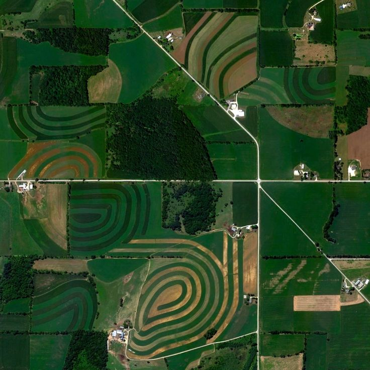 11/7/2014 Drumlins Campbellsport, Wisconsin 43.576863294°, -88.360019821°  A drumlin is a mound, shaped like an inverted spoon or half-buried egg, that is produced by receding glacial ice. When that land is then used for agricultural purposes - like the drumlins seen here in Campbellsport, Wisconsin - circular patterns rise to mimic the landscape and make cultivation possible.
