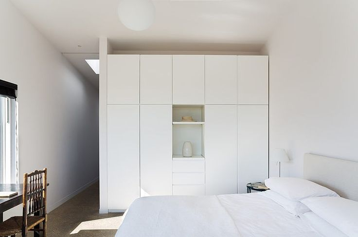 Not exactly floor to ceiling storage, but minimal and should work in most of the bedrooms.