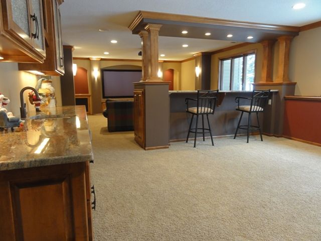 finished basement - like idea of bar between pool table and couch area - color scheme