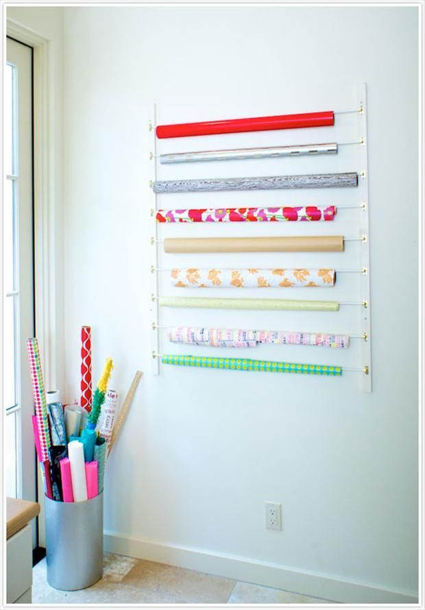 Sash curtain rods for bolts of wrapping paper.