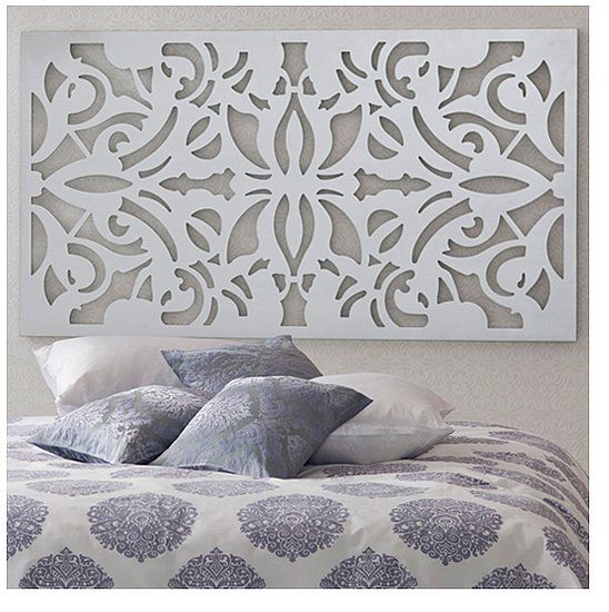 Headboards - The artwork above the bed almost looks like an intricate iron headboard, only much lighter with a coat of white paint.