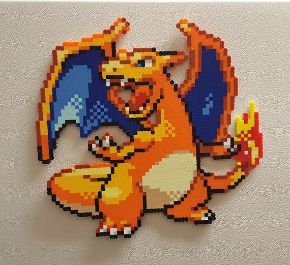 Charizard used Blaze! Its super effective! Take this awesome Charizard Pokemon and challenge your local gym leader. Click the Add to Cart button now, so you can start catching em all! Impress your fellow trainers by owning this awesome sprite.  Charizard measures 12 inches tall by 12 inches wide.  Pallet Town needs you to place him on your locker, or fridge. Hang him on your door, make a greeting card with an awesome pixel sprite on it, or put him on the wall and be the envy of all your…