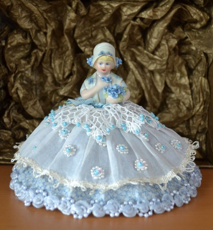 Beautiful Handpainted Blue Belle Porcelain Pin Cushion Half Doll. This adorable half doll is decorated in pale blue colours. Belle has blonde hair and has a pale blue hat with pale blue handmade forget me not flowers and edged in gold.   eBay!