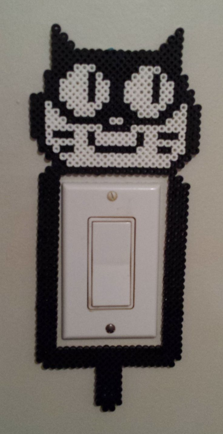 Perler cat light switch.