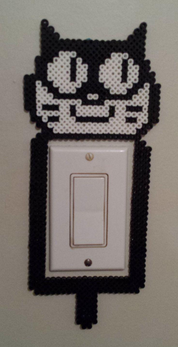 Perler cat light switch.