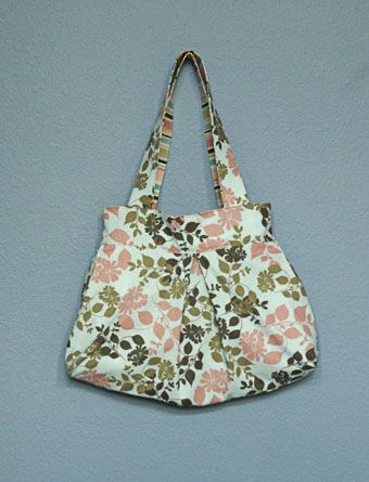 "Used this pattern to make purse for Sarah for Christmas. Pretty easy for a novice like me, but the ""engineer"" on this blog should make better drawings of how to cut the lining piece in the shape of a trapezoid. I wasted one set of lining fabric because that drawing was not clear and I had to redo."