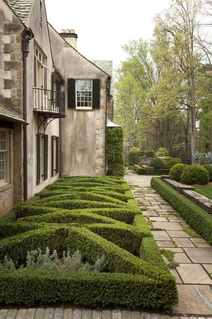Boxwood House Garden west parterre by Howard Design Studio. Box hedge by slab paving