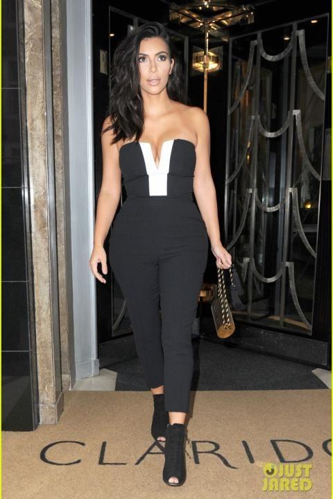 Kim Kardashian wearing Yves Saint Laurent Vintage Gold Tassel Clutch.