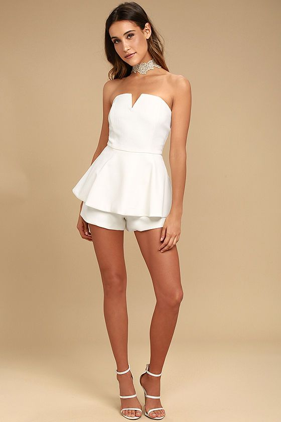 Whatever the occasion, the Where You Are White Strapless Romper will be a hit! Medium-weight woven fabric shapes a strapless neckline with a hidden V-bar and no-slip strips. Flaring peplum tops structured shorts. Hidden back zipper/clasp.