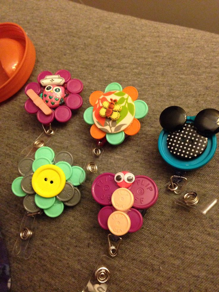 Designed badge holders made from buttons and colorful vaccine vial caps (recycled... :) I'm loving crafts :)