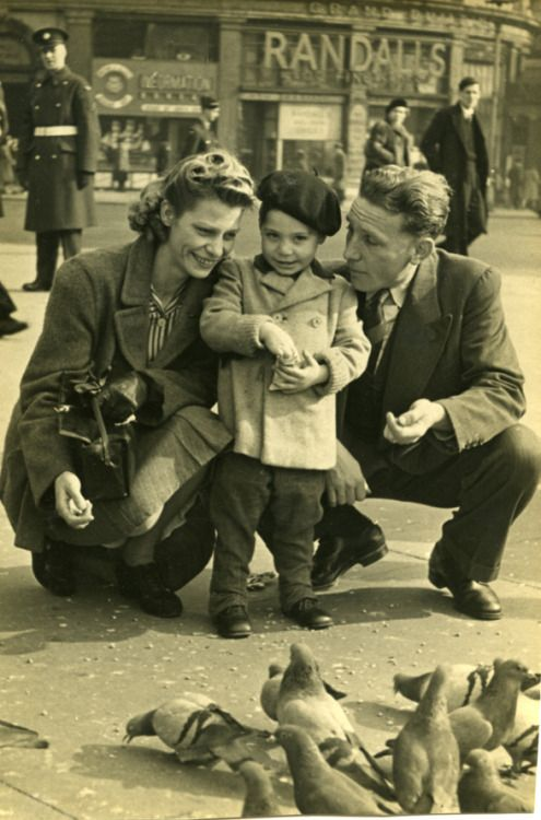 """rollingstonesofficial:  """"A stylish Charles Robert Watts aged 2 with his mother Lillian and father Charles in Piccadilly Circus in 1943. Charlie was known as 'Charlie Boy- while his dad was called 'Charlie'. Part of the Rolling Stones..."""