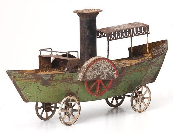 antique  Tin Boat on wheels