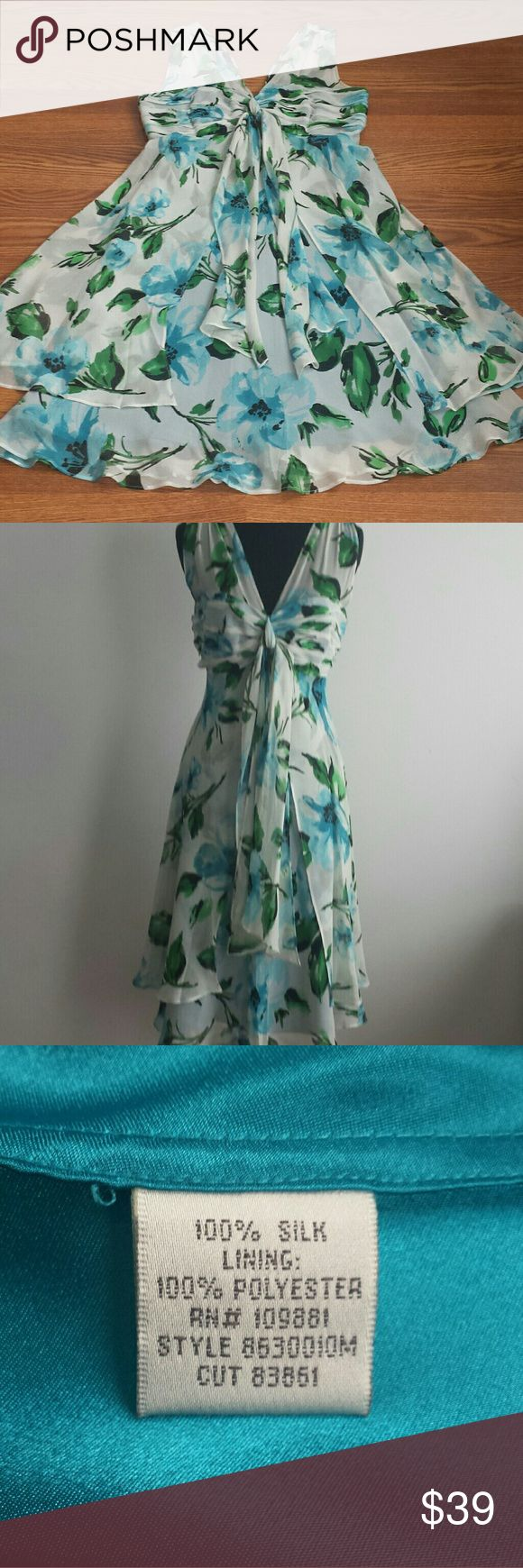 "Donna Ricco Silk Dress Gorgeous silk chiffon floral dress in white, blue, and green from Donna Ricco. Flattering A-line cut and necklibe. Would be perfect for a wedding, a graduation, a christening, etc. Measurements: Length = 42"";  Bust = 36""; Waist = 33""; Hips = 40"". Donna Ricco Dresses"