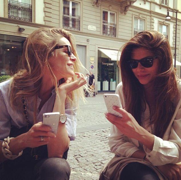 Stylish Italian girls with stylish iphone cases