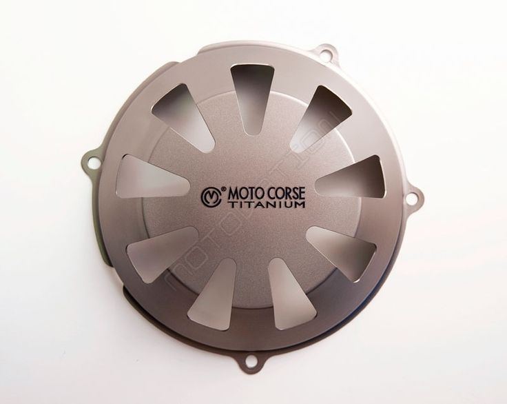 """102185018 Titanium Clutch Cover for Dry Clutch Ducati by MotoCorse This Titanium clutch cover by Moto Corse named the """"Endurance"""" can be easily installed on all Ducati models with a dry clutch. Made in beautiful Titanium and perfectly interchangeable with the stock clutch cover. Installs easily with 4 screws. Classic MotoCorse 9 hole design makes this a truly custom part for your Ducati. MotoCorse Part # 102185018 Make/Model/Year Ducati / 998 / 2002, Ducati / 998 / 2003, Ducati / 998…"""