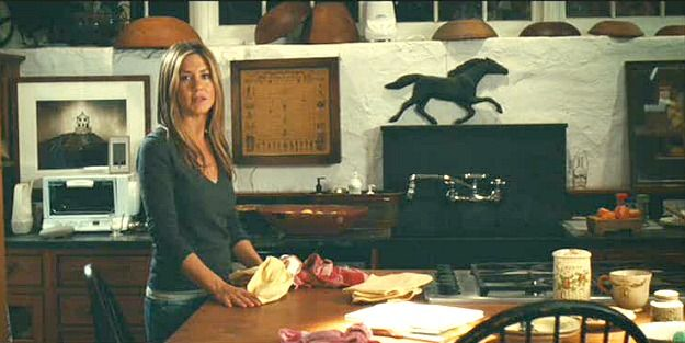 Soapstone sink and backsplash in relation to picture.Jennifer Aniston in the kitchen Marley and Me