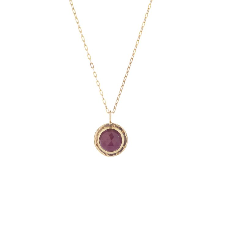 A 8mm Indian ruby, bezel set in 9ct yellow gold, on a thin gold chain.